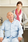 Extended home care for senior man. Extended home care for senior men in wheelchair Stock Photos