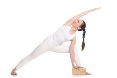 Extended Side Angle Pose Yoga with block Royalty Free Stock Photo