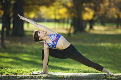 Extended side angle pose Stock Images