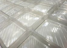 Extended transparent plastic boxes. As abstracts background in the market royalty free stock photography