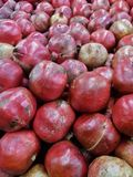 Extended view of shiny deep pink fresh organic pomegranates. Beautiful pink red pomegranates in a heap stock photo