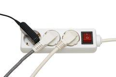 Extensión eléctrica y enchufe eléctrico Imagen de archivo libre de regalías