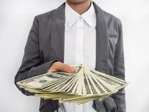 Extensión de la mujer de negocios del dinero (U.S.Dollars) Imagen de archivo libre de regalías
