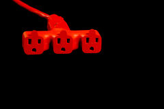 Extension Cord. An orange extension cord connected to a three way splitter royalty free stock image