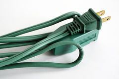 Extension Cord. A green extension cord against white stock photo