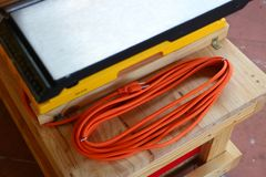 Extension cord of cross cut sled Stock Photo