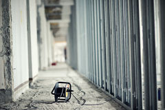 Extension cord. Lying at construction site stock images