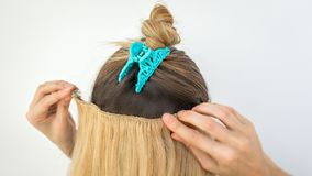 Extension of natural hair with hairpins clips. Extension of natural hair with hairpins and clips royalty free stock images