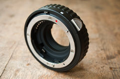 Extension ring for lens  camera on wooden background Stock Image