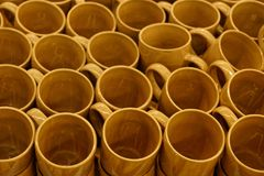 Extension from a set of brown cups on a table royalty free stock image