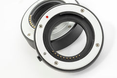 Extension tube used for macro photography on white background Stock Images