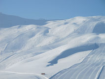 Extensive ski piste and powder snow off piste. Skiing Les Contamines, French alps Stock Photo