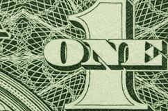 Extreme close up of ONE and 1 from an American dollar bill. royalty free stock photos