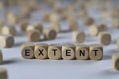 Extent - cube with letters, sign with wooden cubes. Extent - wooden cubes with the inscription `cube with letters, sign with wooden cubes`. This image belongs to stock photography