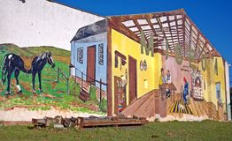 Exterior Agricultural Museum Wall Mural. This mural at the Bathurst Agricultural museum was painted on the one end of the vintage tractor shed by art students Royalty Free Stock Photo