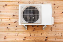 Exterior airconditioning unit on a wooden wall. Exterior airconditioning unit on a wooden wall Stock Images