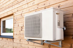 Exterior airconditioning unit on a wooden wall. Exterior airconditioning unit on a wooden wall Royalty Free Stock Photography