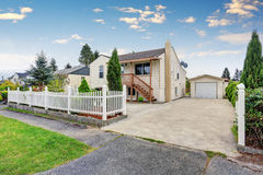 Exterior of American bungalow style house with garage and driveway Royalty Free Stock Images