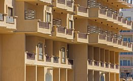 Exterior of an apartment block construction in tropical resort. Outside exterior of an apartment block construction project in tropical holiday resort with Stock Photos