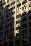 Exterior art deco modern office building facade in city with decorative cartouche emblems stock photo