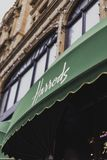 The exterior and awnings of Harrods luxury department store in L. LONDON, UNITED KINGDOM - August 15th, 2014: the exterior and awnings of Harrods luxury Royalty Free Stock Image