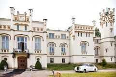 Exterior of a beautiful old house with white retro car.  Stock Photos
