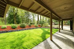 Exterior of Beautiful Secluded home. Exterior of Secluded home with long covered entrance porch and Beautiful landscape design. Northwest, USA Stock Photos
