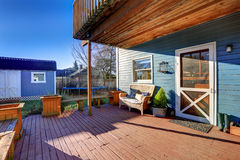 Exterior of blue craftsman house with covered back porch Royalty Free Stock Image