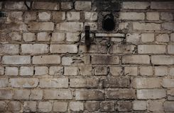 Exterior Brick Wall with Stained and Peeling White Paint and Burnt Wall stock image