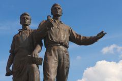 Exterior of the bronze sculpture of workers at the Green Bridge in Vilnius, Lithuania. Stock Photos