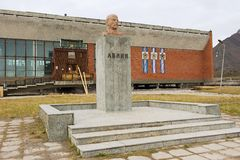 Exterior of the bust of Lenin in the abandoned Russian arctic settlement Pyramiden, Norway. Stock Photos