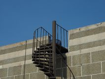 Exterior cantilevered metal spiral staircase stock image