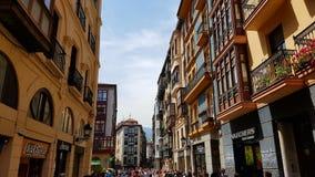 Exterior of Casco Viejo, Bilbao, Spain. Facade of shops and homes along walk in Casco Viejo, Bilbao, Spain on sunny day royalty free stock photography