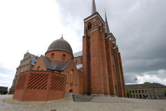 Exterior of the cathedral of Roskilde in Denmark royalty free stock photo