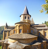 Exterior chapels and turrets. From the 13th century, Abbey Church of St. Foy, Conques, France Stock Photo
