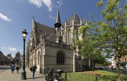 Exterior of the Church Notre Dame Du Sablon with people who walk by it. Stock Photo
