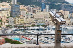 Exterior of the coin operated binocular at the viewpoint with the urban panorama at the background in Monaco. Royalty Free Stock Photography