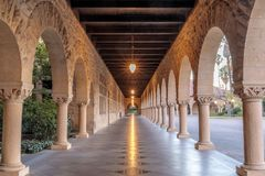 Exterior colonnade hallway of Stanford University Campus Building. The Main Quad in Stanford University in Santa Clara County California USA royalty free stock photos