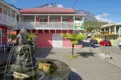 Exterior of the colorful buildings at the town of Fond de Rond Point in Saint-Denis De La Reunion, France. Stock Image