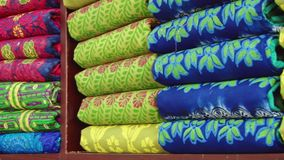 Exterior of the colorful stamp print cloth at the workshop at the New Market in Dhaka, Bangladesh. stock footage
