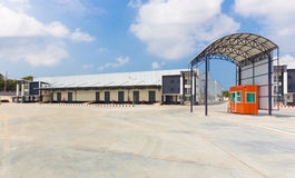 Exterior of a commercial warehouse with a scale weigh station be Royalty Free Stock Images