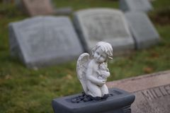 Exterior daytime shallow depth of field stock photo of angel on gravestone in Mount Hope cemetery Stock Photos