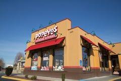 Exterior de la ubicación del restaurante de la cocina de Popeyes Luisiana Imagen de archivo libre de regalías