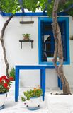 Exterior decoration of flowers and pots in greek style Stock Photos