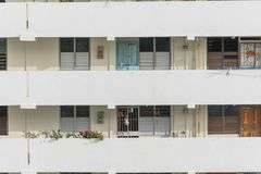 Exterior dense of HDB apartment complex in Singapore. Exterior dense of HDB housing flats with sun drying hanging clothes line in Singapore. Urban concept with Royalty Free Stock Photos