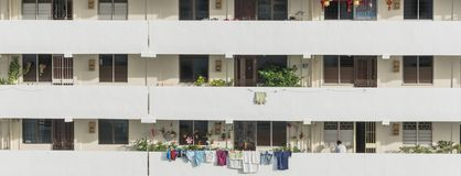 Exterior dense of HDB apartment complex in Singapore. Exterior dense of HDB housing flats with sun drying hanging clothes line in Singapore. Urban concept with Royalty Free Stock Image