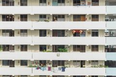 Exterior dense of HDB apartment complex in Singapore. Exterior dense of HDB housing flats with sun drying hanging clothes line in Singapore. Urban concept with Stock Photography