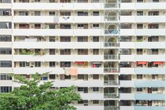 Exterior dense of HDB apartment complex in Singapore. Exterior dense of HDB housing flats with sun drying hanging clothes line in Singapore. Urban concept with Stock Image