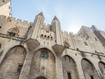 Archiecture of Papal palace in Avignon. Exterior design architecture of Papal palace Palais des papes under clear blue sky in Avignon, France royalty free stock images