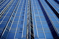 Exterior Design of Glass and Steel. Design of glass and steel skyscraper rises into the sky Stock Photo